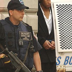 FILE - In this  July 30, 2003  file photo, Ronell Wilson is escorted past a corrections officer after appearing in court in the Staten Island borough of New York, where he faced charges of shooting two undercover police officers during a buy-and-bust operation, in New York. Convicted in the cold-blooded killings of the officers, Wilson has been thrown into solitary confinement while he awaits resentencing in the death penalty case. Wilson's lawyers say he's been a model prisoner and are demanding to know why he's been segregated at a Brooklyn lockup.