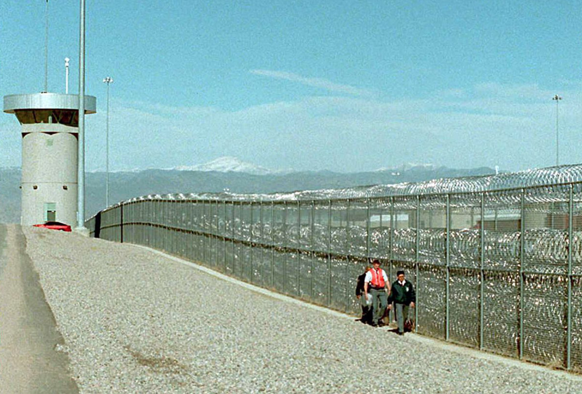 Guards walk along the fence at the super-maximum-security federal prison in Florence, Colorado, where Larry Hoover is being held.