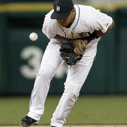 Detroit Tigers shortstop Jhonny Peralta bobbles a Seattle Mariners' Casper Wells ground ball in the third inning of a baseball game in Detroit, Wednesday, April 25, 2012. Peralta was charged with an error on the play.