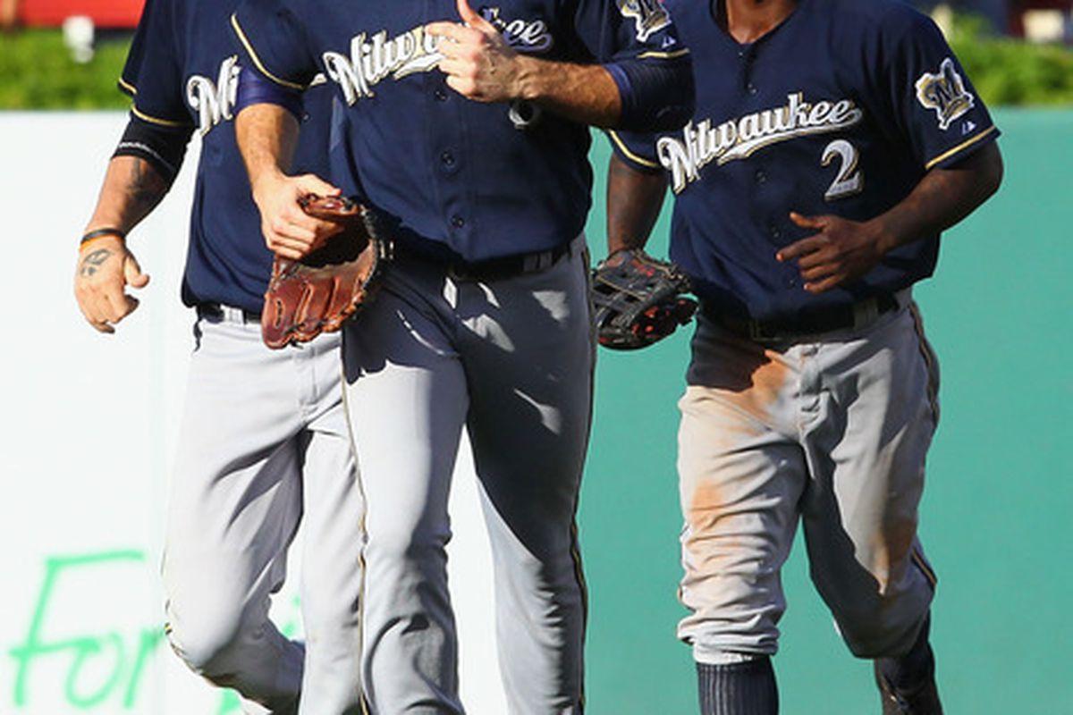Corey Hart, Ryan Braun and Nyjer Morgan return to the dugout after deafeating the St. Louis Cardinals 4-1 Monday.
