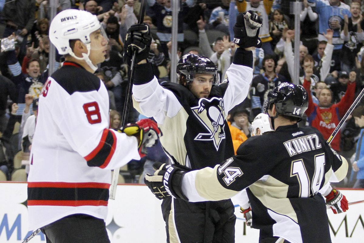 The Penguins celebrate after scoring their fifth goal of the game. Dainius Zubrus' expression says it all.