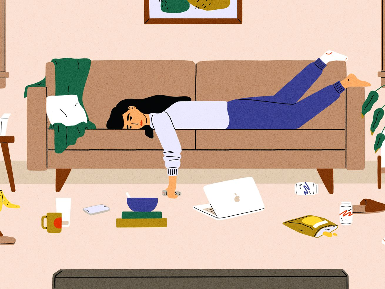 A woman in sweats lies lazily on her couch clutching a remote control in front of the television. A laptop, snacks, and old dishes lie on the floor in front of her.