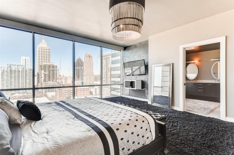 A huge condo bedroom with views across Atlanta's skyline.