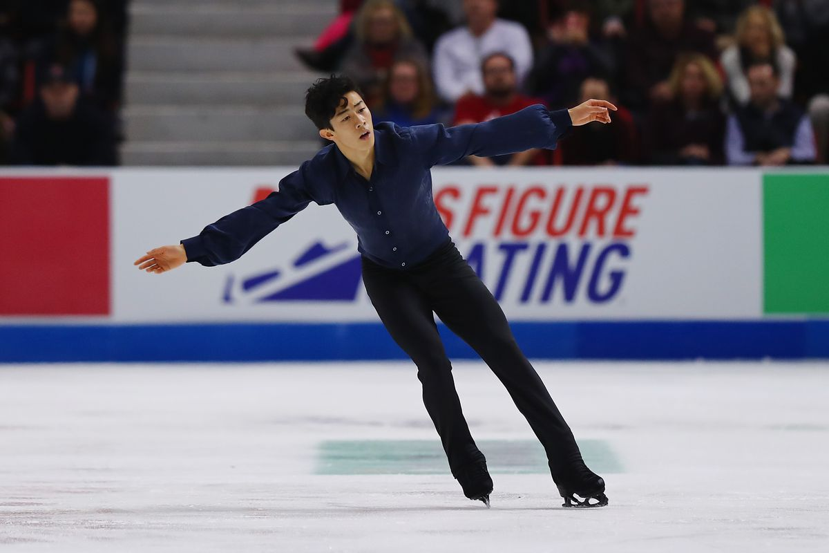 Figure skater Nathan Chen lands a jump on the ice