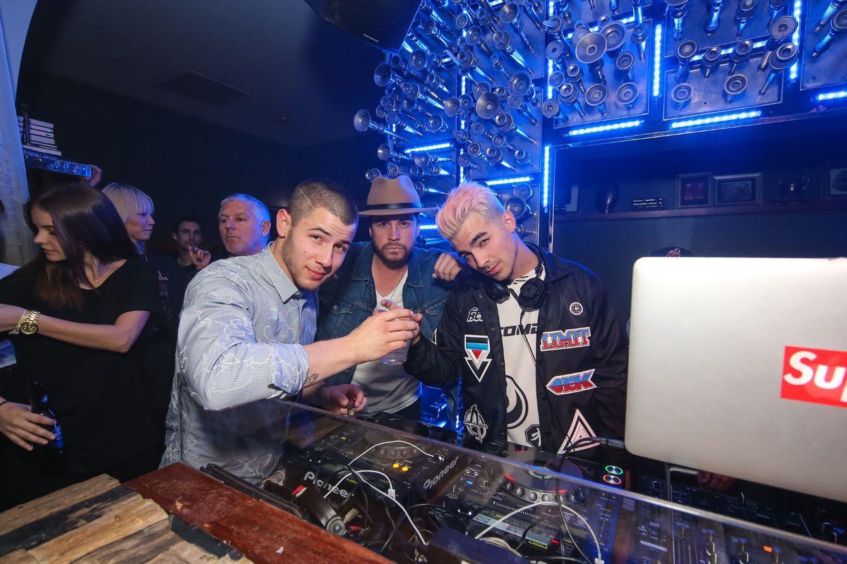 Nick Jonas, Dave Osokow and Joe Jonas at Hyde Bellagio