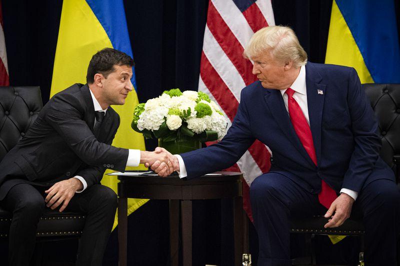 President Trump and Ukrainian President Volodymyr Zelensky shake hands.