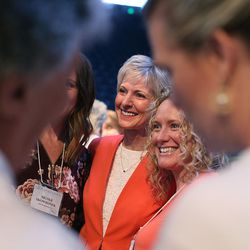 Sister Jean B. Bingham, LDS Church Relief Society general president, center, is photographed with attendees of the BYU Women's Conference in the Marriott Center at BYU in Provo on Friday, May 5, 2017.