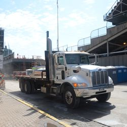 11:00 a.m. Truck backs into the work site on Waveland -