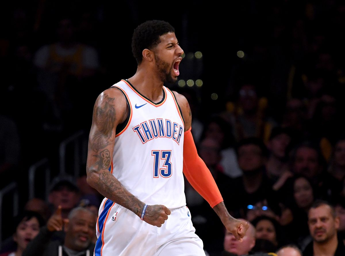 Oklahoma City Thunder All-Star Paul George yelling in celebration on the court
