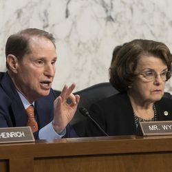 Sen. Ron Wyden, D-Ore., left, as Sen. Dianne Feinstein, D-Calif., looks on, questions top national security chiefs as the Senate Select Committee on Intelligence discusses gathering intelligence on foreign agents, on Capitol Hill in Washington, Wednesday, June 7, 2017.