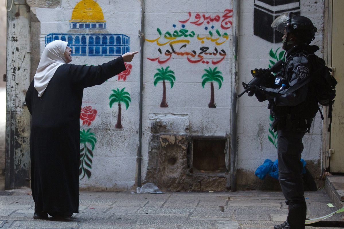 A Palestinian woman points at an Israeli policeman in Jerusalem's Old City.