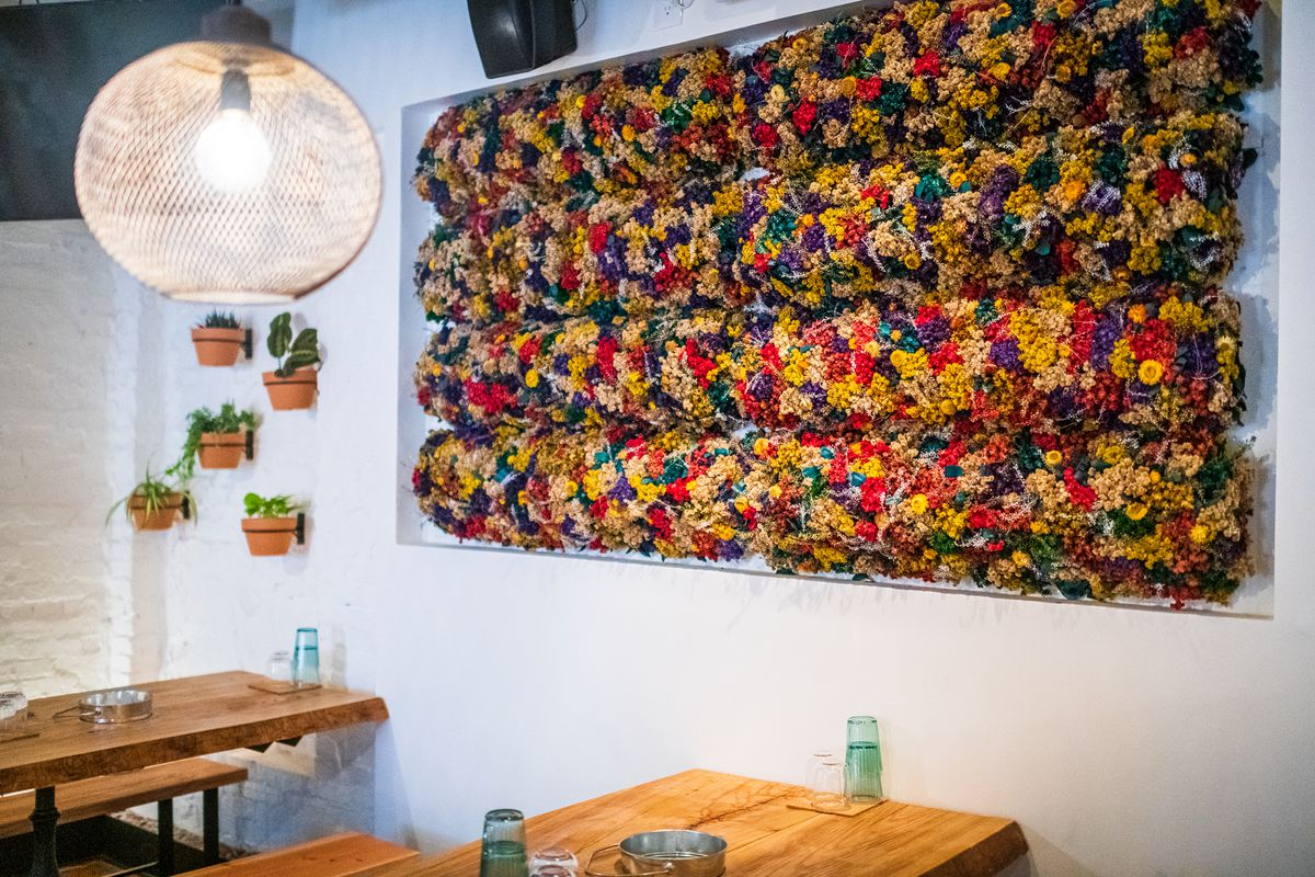 A flower display from a Guatemalan artist gives Lulu's Winegarden a distinct, sweet smell