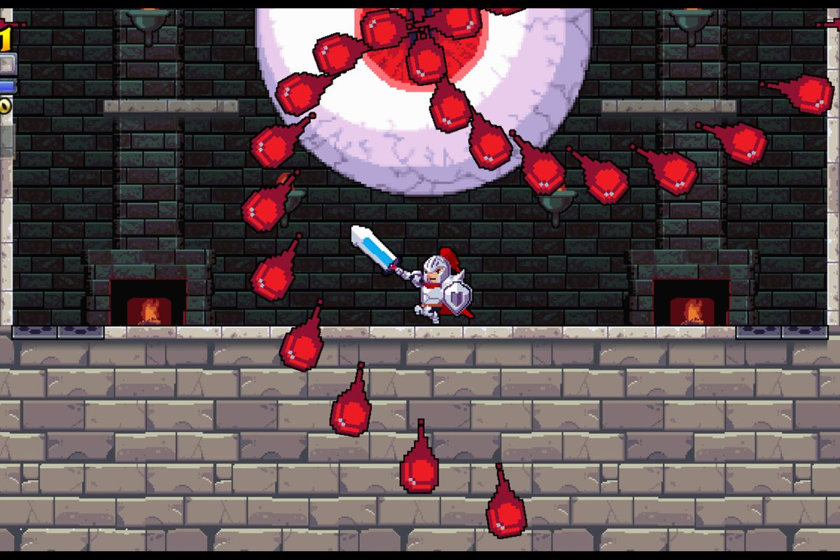 A knight battles a giant eyeball in a dungeon in a screenshot from Rogue Legacy