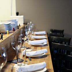 The open kitchen allows guests to watch the chefs work.