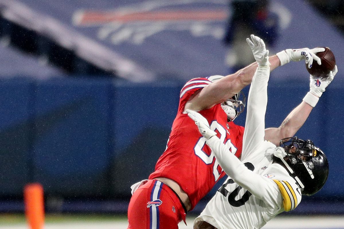Dawson Knox #88 of the Buffalo Bills drops a pass as Cameron Sutton #20 of the Pittsburgh Steelers defends him during the second quarter at Bills Stadium on December 13, 2020 in Orchard Park, New York.