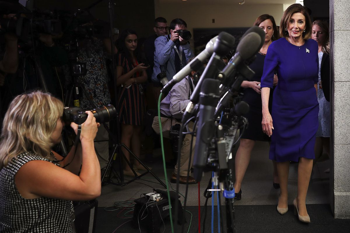 Speaker of the House Rep. Nancy Pelosi walks into a meeting with House Democrats.