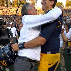 California Golden Bears head coach Sonny Dykes hugs California Golden Bears quarterback Davis Webb after they beat the Utah Utes in a football game at the California Memorial Stadium in Berkeley, Calif., on Saturday, Oct. 1, 2016. Utah lost 23-28.