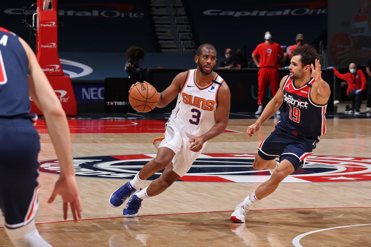 Chris Paul of the Phoenix Suns drives to the basket against the Washington Wizards on January 11, 2021 at Capital One Arena in Washington, DC.