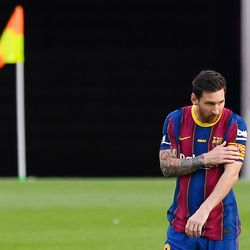 Messi shows off Barca's new home shirt