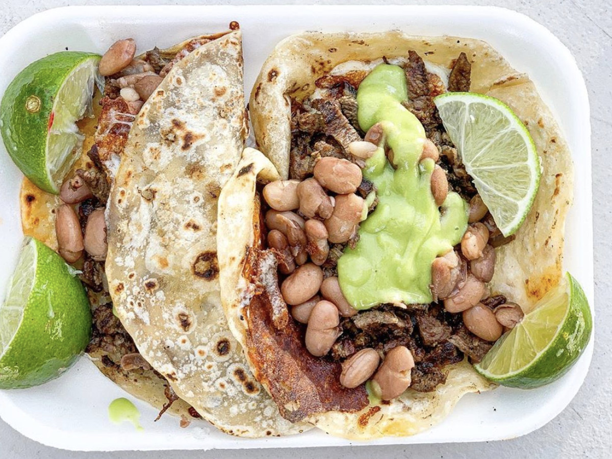 Carne asada tacos at El Ruso, burnished brown from the comal and with lots of avocado salsa.
