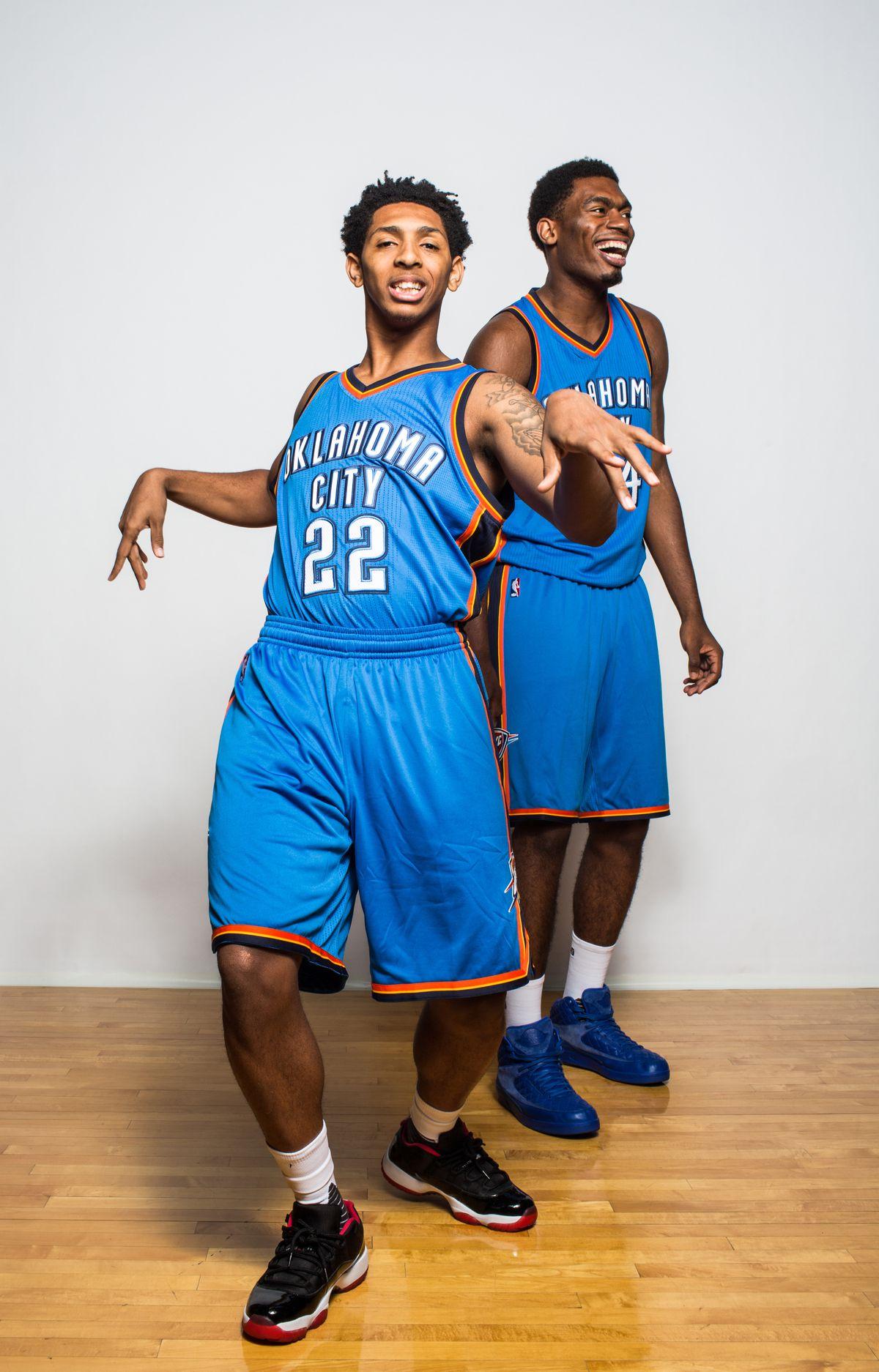 Cameron Payne #22 and Dakari Johnson #33 of the Thunder pose during 2015 NBA rookie photo shoot. (Getty Images)