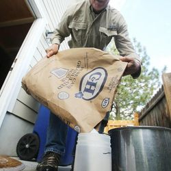 Veldon Sorensen mixes sugar and water to feed his bees at his home in Salt Lake City on Sept. 13. Sorensen is retired from Bayer but still consults for the company and others about bees.