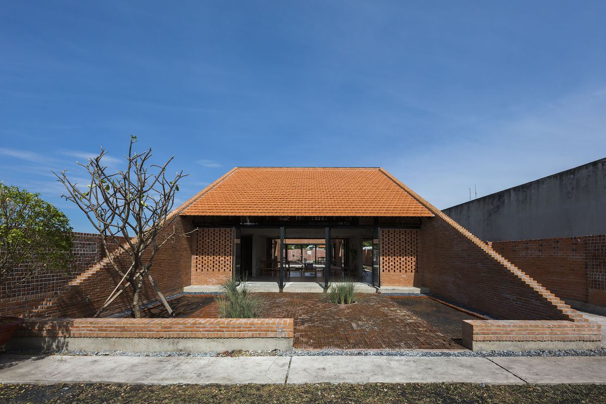 Exterior of trapezoidal brick house