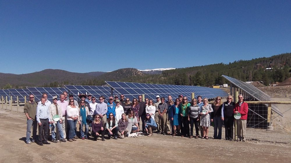 A happy community with their shared solar project just outside Breckenridge, Colorado.