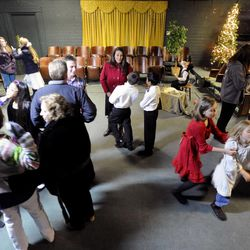 """The cast mingles after performing """"The Best Christmas Pageant Ever"""" at the Valley Center Playhouse in Lindon on Thursday, Dec. 12, 2013. Owners Keith and Jody Renstrom are closing the playhouse on Dec. 21 after 38 years of community theater."""