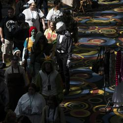 People parade through the Salt Palace Convention Center at the kickoff of the Salt Lake Comic Con in Salt Lake City, Thursday, Sept. 4, 2014.