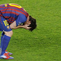 Barcelona's Lionel Messi holds his head after Chelsea advanced 3-2 on aggregate.
