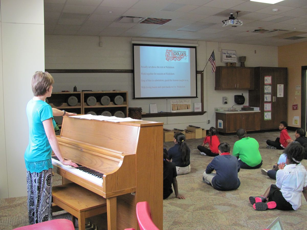 Amber Price leads a lesson on singing the school song for her fourth-grade class at IPS School 70.