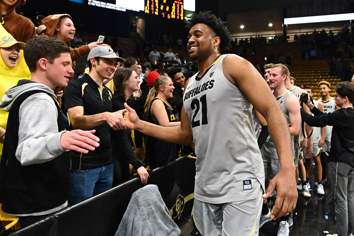 Colorado Buffaloes forward Evan Battey celebrates with fans after defeating the Washington Huskies at the CU Events Center.