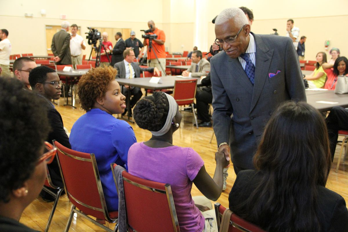 Mayor A C Wharton greets Shelby County high school students during a summer program graduation ceremony in July.