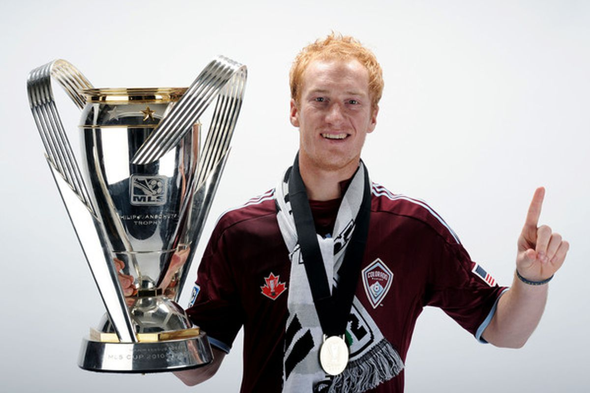 TORONTO ON - NOVEMBER 21:  Jeff Larentowicz #4 of the Colorado Rapids poses with the Philip F. Anschutz MLS Cup trophy following the MLS Cup final at BMO Field on November 21 2010 in Toronto Canada.  (Photo by Harry How/Getty Images)