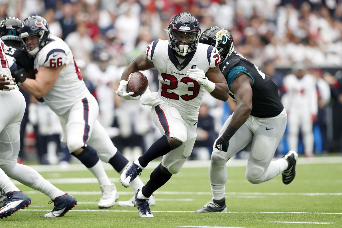 Carlos Hyde of the Houston Texans runs the ball in the second half against the Jacksonville Jaguars at NRG Stadium on September 15, 2019 in Houston, Texas.