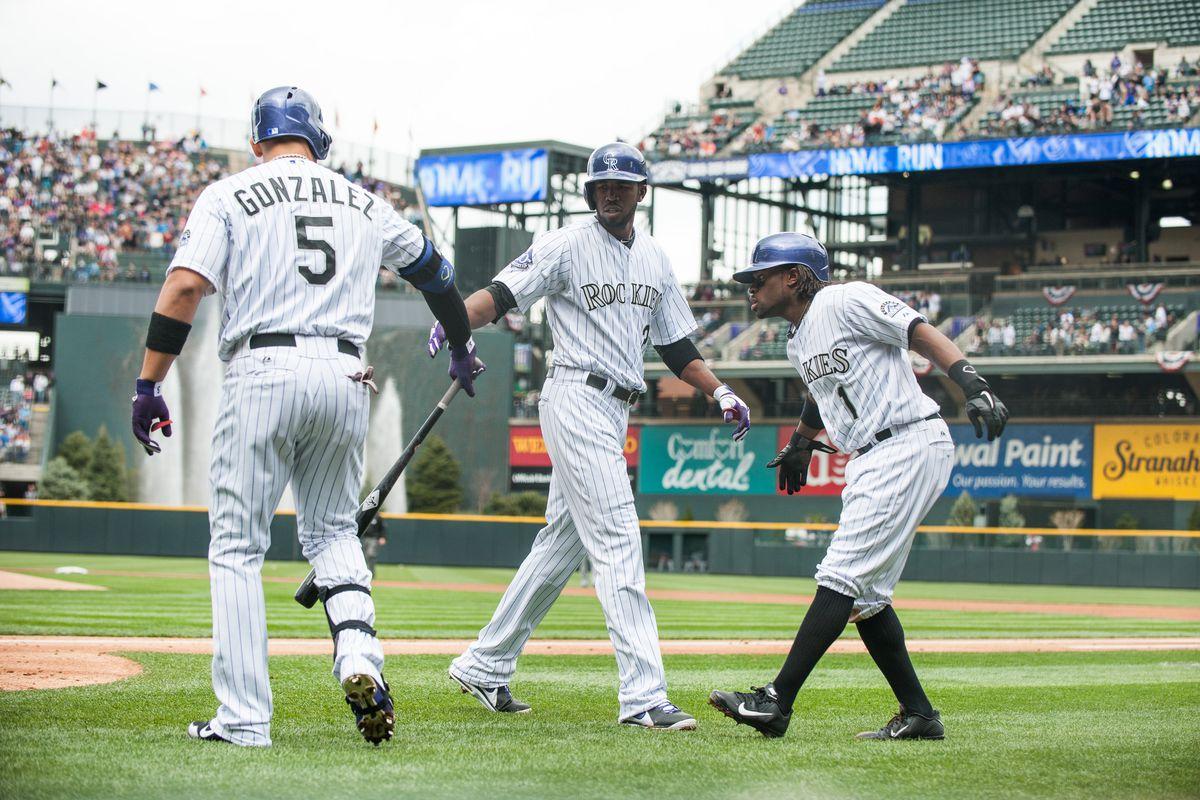 Dexter Fowler being congratulated after his 1st inning 2 run HR.