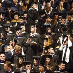 Students wait for the start of Spring Commencement Exercises at BYU Thursday, April 19, 2012 at the Marriott Center.