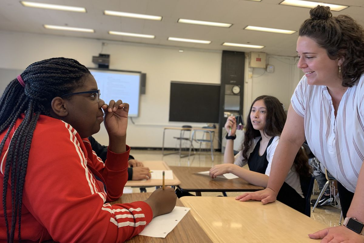 Chemistry teacher Shelby Redman checks in with a student named Jamaria during Freshman Connection at Roberto Clemente Community Academy in August 2019.
