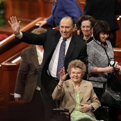 President of The Church of Jesus Christ of Latter-day Saints Thomas S. Monson and his wife, Frances, wave to the crowd after The Church of Jesus Christ of Latter-day Saints 181st Annual General Conference on Sunday, April 3, 2011, in Salt Lake City, Utah.