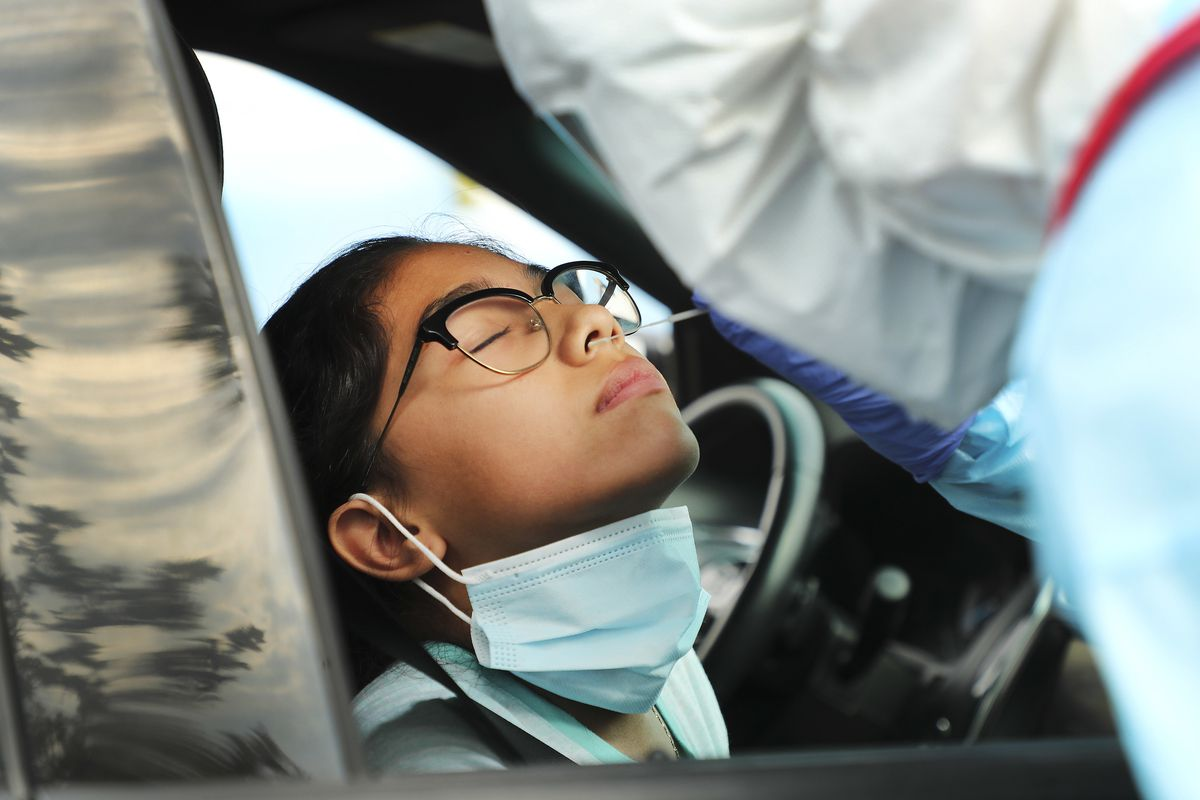 Dijanette Alcaraz, 12, is tested for COVID-19 by the Salt Lake County Health Department in the parking lot of the Maverik Center in West Valley on Sunday, Aug. 23, 2020. The free testing was set up for residents ofKearns, Magna, Taylorsville, West Valley City or the west side of Salt Lake City.
