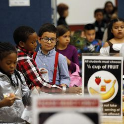 Students choose their food during the Breakfast in the Classroom program at Backman Elementary School in Salt Lake City on Friday, Oct. 28, 2016.