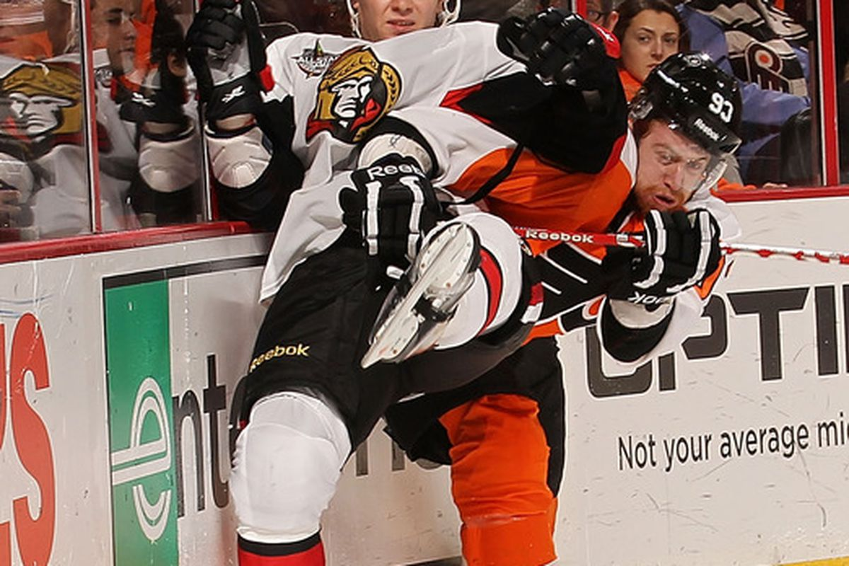 Here's Zack Smith chilling against the glass. (Photo by Nick Laham/Getty Images)