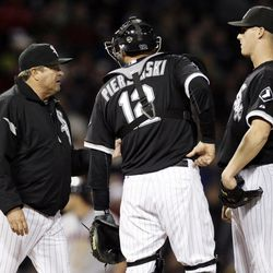 Chicago White Sox pitching coach Don Cooper, left, talks with catcher A.J. Pierzynski, center, and relief pitcher Nate Jones during the sixth inning of a baseball game against the Cleveland Indians in Chicago, Wednesday, Sept. 26, 2012.