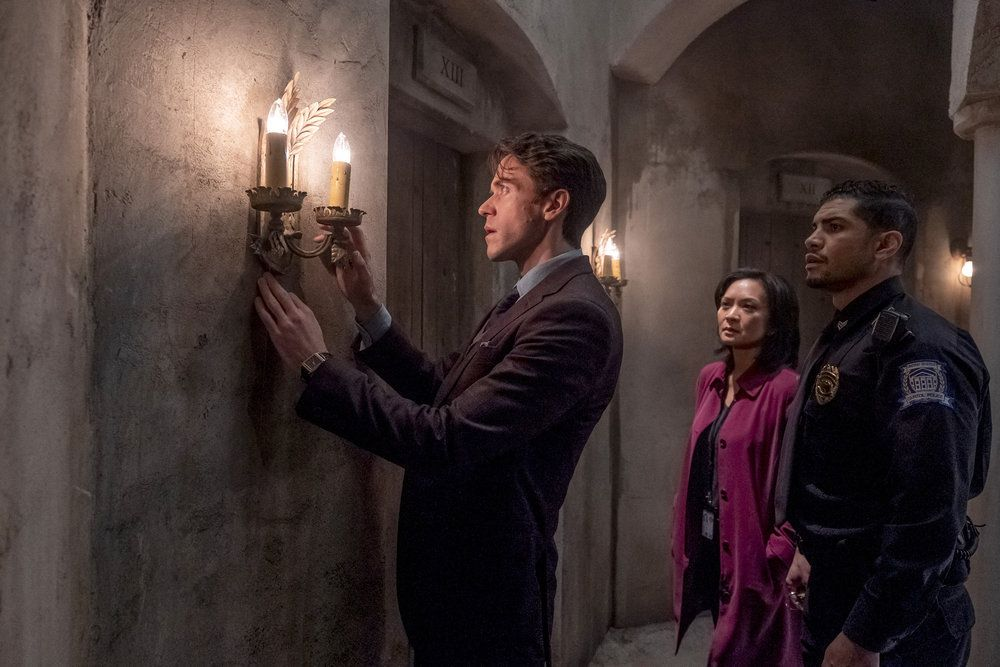 robert langdon fiddles with something on the wall