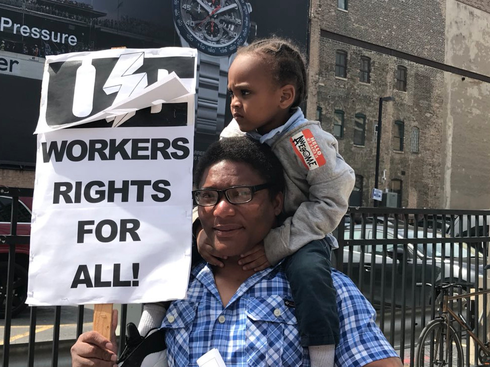 A father and his son advocate for workers right at a May Day rally Tuesday, May 1, 2018 at the Haymarket Monument on the Near West Side. | Matthew Hendrickson/Sun-Times