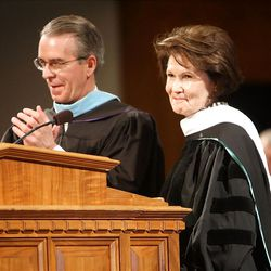 Sister Patricia T. Holland, right, accepts the 2012 Distinguished Alumnus Award from College President J. Lawrence Richards during LDS Business College's 125th Commencement in the Tabernacle on Temple Square in downtown Salt Lake City Friday, April 13, 2012.