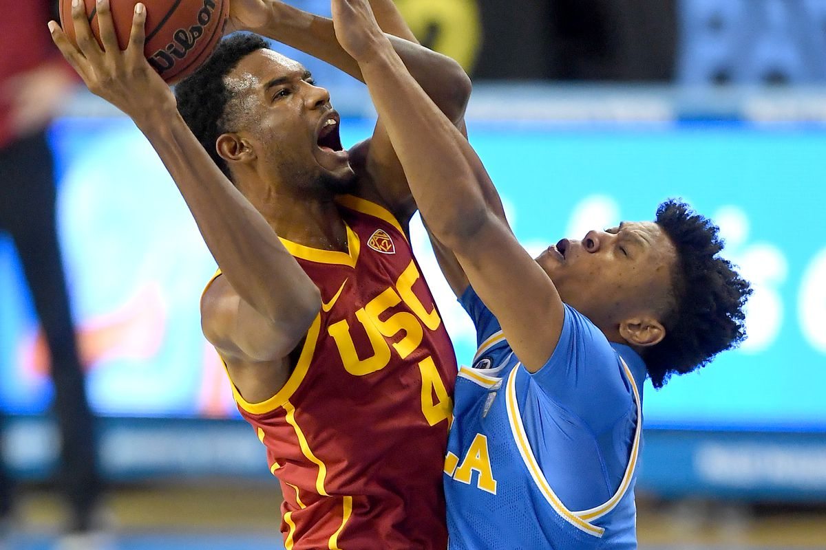 Evan Mobley of the USC Trojans makes a basket over Jaylen Clark of the UCLA Bruins in the first half of the game at Pauley Pavilion on March 6, 2021 in Los Angeles, California.