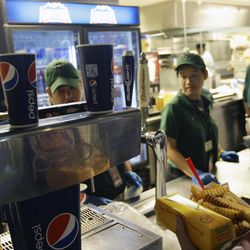 Emilio Cordova, right, chooses a soft drink during a baseball game between the New York Mets and the Washington Nationals Wednesday, Sept. 12, 2012, in New York.