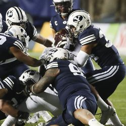 The Brigham Young Cougars defense gang tackles Texas State Bobcats running back Brock Sturges (5) in Provo on Saturday, Oct. 24, 2020.